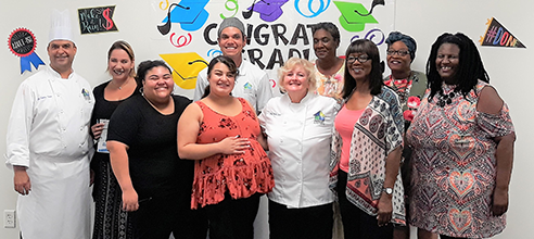 Graduates of the free Culinary Training Program at Pathlight Kitchen celebrate the completion of their 12-week course in cooking and hospitality management