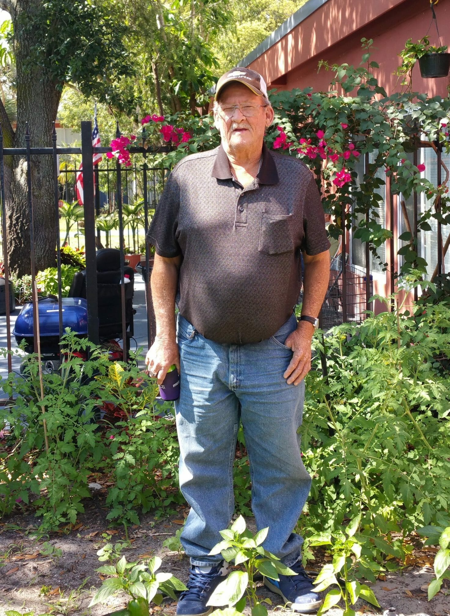 Allen, a resident of the Orlando Permanent Supportive Housing program at Pathlight HOME, in his garden